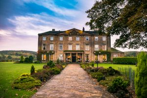 Walton Hall in a scenic setting of rolling parkland.